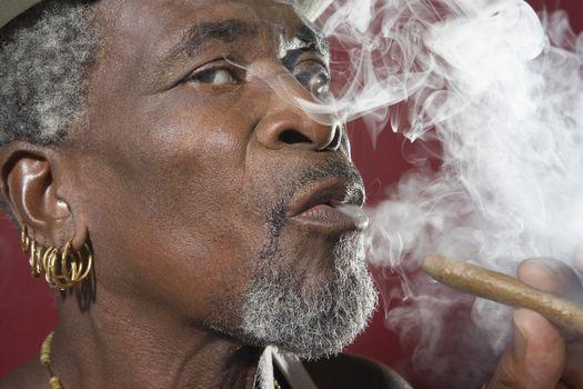 Man exhaling cigar smoke