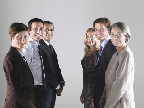 Two groups of businesspeople in two rows