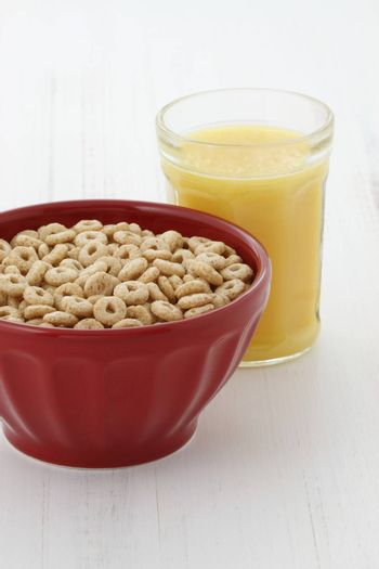 Delicious and nutritious lightly toasted honey, nuts and oats cereal with orange juice.