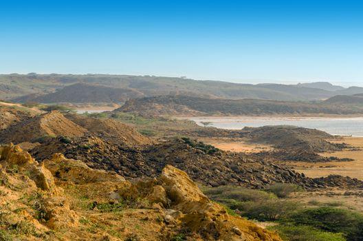 Dry barren desert landscape next to an ocean in La Guajira, Colombia