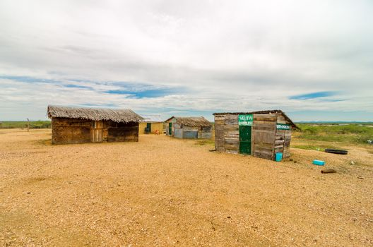 Wooden shacks in a desert in La Guajira, Colombia