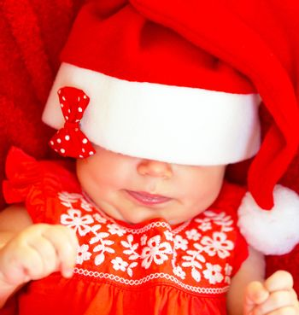 Sweet child wearing Santa hat
