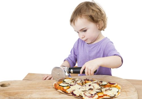 girl using pizza cutter . one person in studio shot isolated on white background