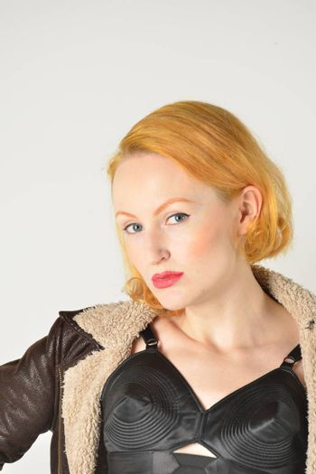 Portrait of red head in retro leather jacket