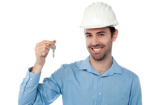 Smiling civil engineer holding key