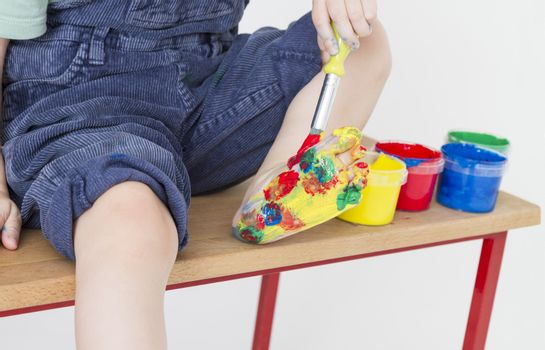 foot of child colorful painted with finger paint
