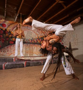 Capoeira Performers Shoulder Throw