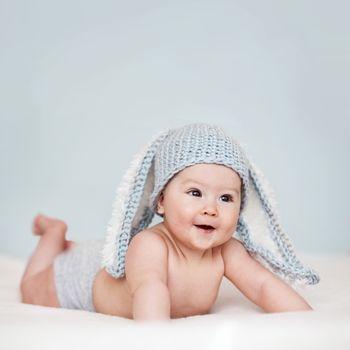 Portrait of a cute 6 months baby wearing rabbit hat