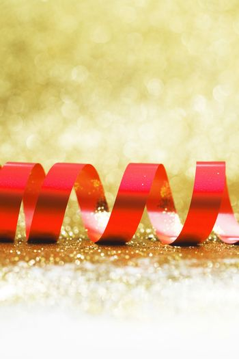 Red ribbon on golden background