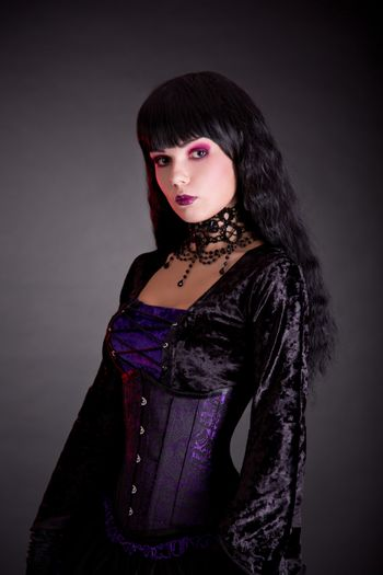 Portrait of beautiful gothic girl in Victorian style clothes