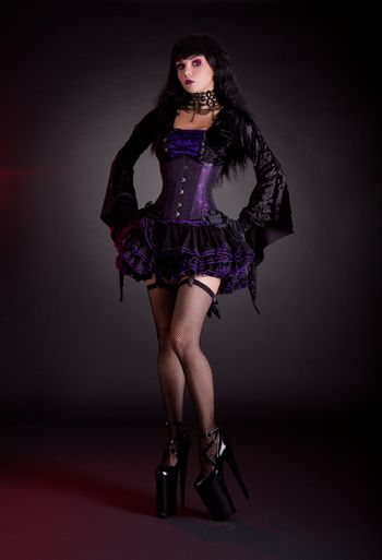 Sexy young woman in black and purple costume