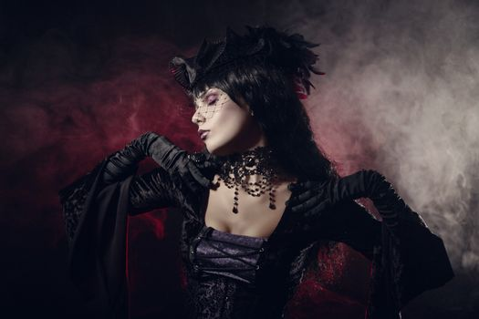 Romantic gothic girl in Victorian style clothes