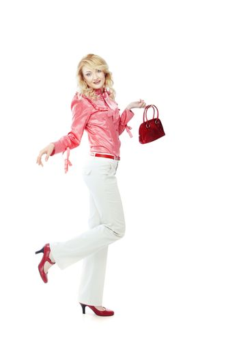 Fashionable lady in shirts and trousers holding red bag