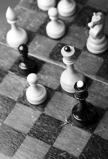Old wooden chess. Monochrome close-up photo