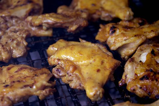 grilled chicken legs on flaming grill
