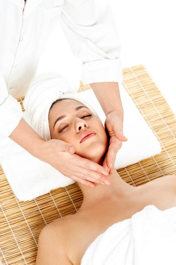 Woman in spa gets a facial massage