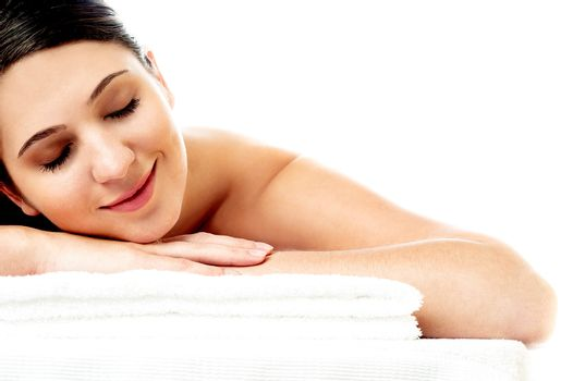 Female with closed eyes relaxng in spa salon