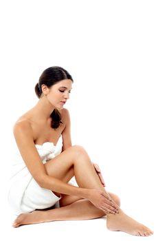 Attractive woman massaging her leg