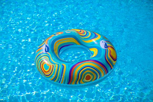 Colorful pool float in blue swimming basin