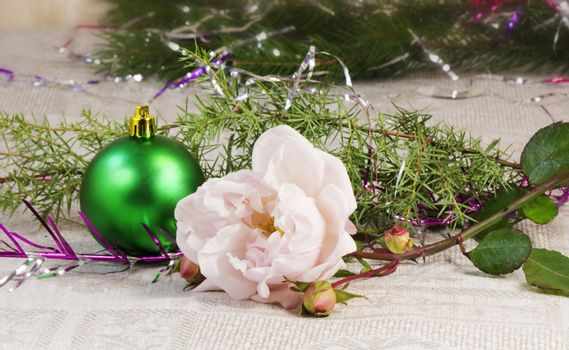 Beautiful shiny green ball , rose and branches of a Christmas tree ornament.