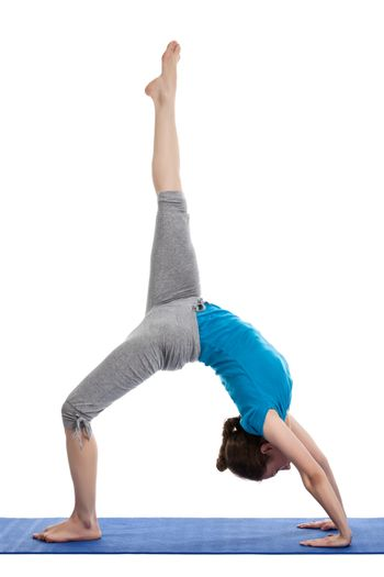 Yoga - young beautiful woman  yoga instructor doing Wheel Pose with one leg lifted straight up (Eka Pada Chakrasana) exercise isolated on white background