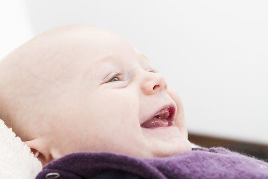 12 week old toddler smiling in horizontal image