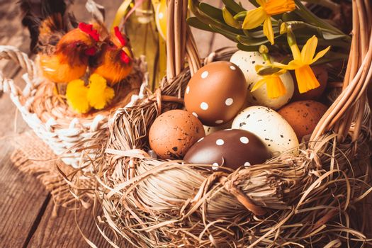 Brown and yellow eggs in basket, Easter decorations
