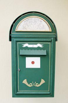 Ancient green mail box a close up