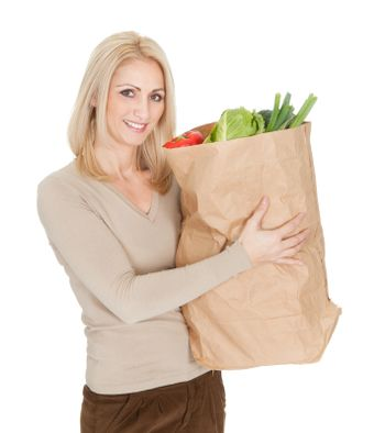 Beautiful woman with grocery bag