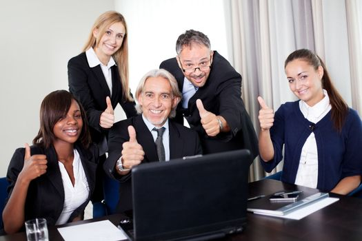Portrait of a group of business people in a meeing