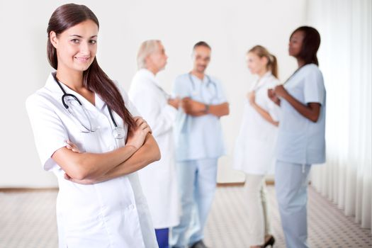 Female doctor with colleagues in the background