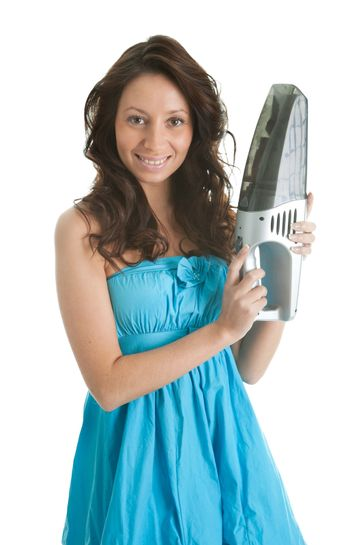 Cheerful woman with handheld vacuum cleaner