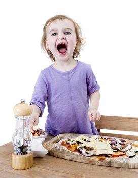 screaming child making fresh pizza. studio shot isolated in white background