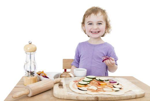 cute child making fresh pizza . studio shot isolated on white background