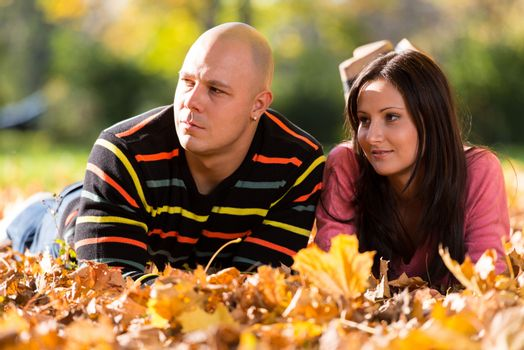 Charming Couple Sitting Together At The Park