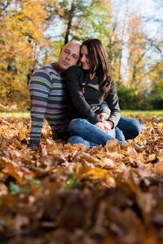 Couple Enjoying In The Beautiful Autumn Day