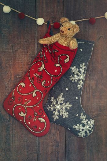 Small teddy bear in stocking for Christmas