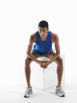 Athlete sitting on a box