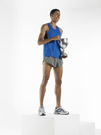 Athlete standing holding trophy