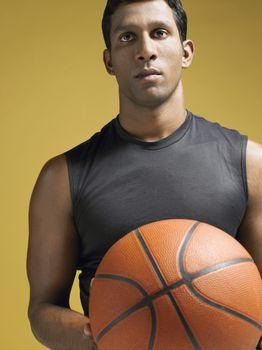 Athlete holding basketball