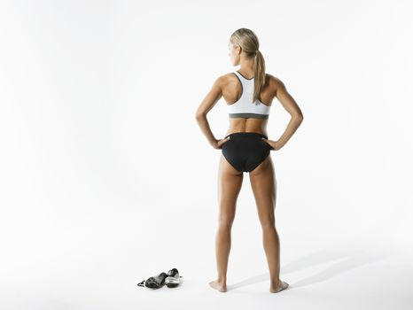 Female athlete standing back view