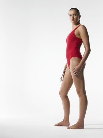 Female athlete standing side view