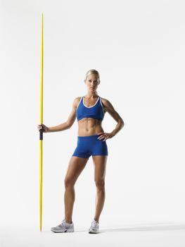 Female athlete holding javelin