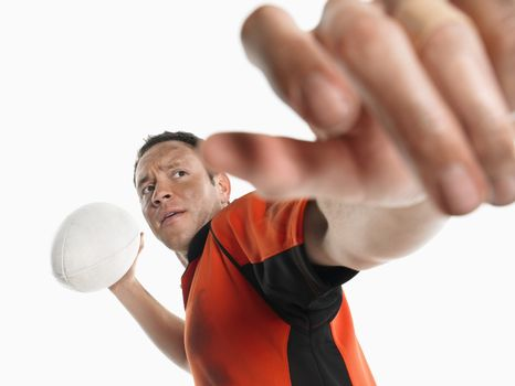 Rugby player preparing to pass ball