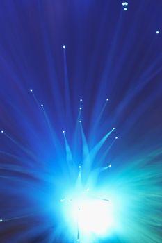 Fiber optics magical lights over blue background
