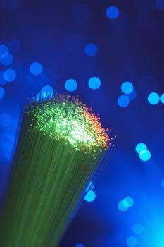 Green fiber optic lights over colored background