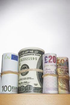 Rolls of currency on shelf