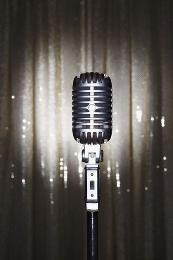 Old fashioned microphone in front of stage curtain