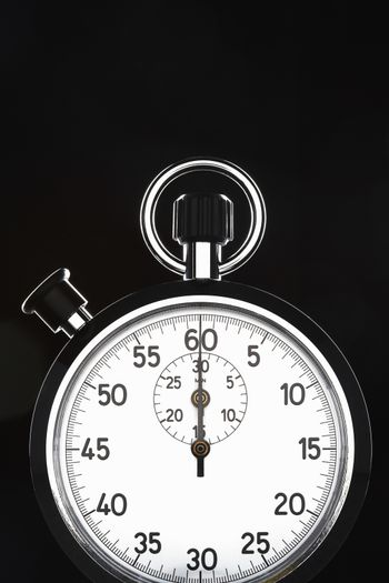 Closeup of stopwatch over black background