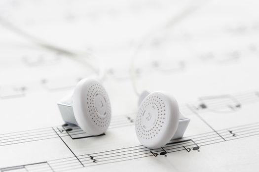 White headphones on sheet music